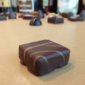 Black tea-orange blossom ganache. Earl grey tea water infusion, milk chocolate couverture and orange blossom water.